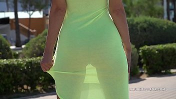 Watch Naughty Lada walks around in a transparent dress in public with no panties preview