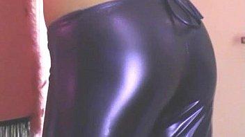 Petite amateur Chloe in shiny purple PVC lingerie