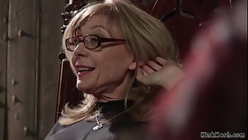 Blonde mature lezdom Nina Hartley in sheer full body lingerie rides face to bound redhead MILF lesbian Maitresse Madeline Marlowe then anal fucks her
