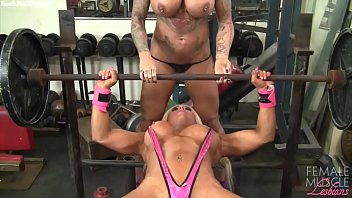 Two female bodybuilders flexing muscles