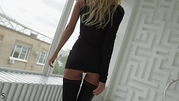 Gorgeous blonde babe wearing black stockings and high heels teasing in exclusive StasyQ video