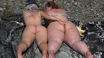 Hairy pussy licking in nature. Lesbians with big asses love oral sex and facesitting.