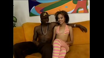 Slender curly haired black slut rides massive ebony dick on the couch