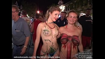 costume cosplay party with girls flashing in the streets of key west