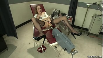 Sexy solo brunette nurse Roxy Rox in black stockings laying in gyno chair with legs spreaded and fucking machine then with suctioned nipples squirting