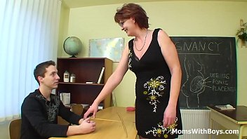 A mature redhead teacher with big tits hungry for young cocks