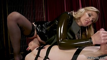 Male Tony Orlando in gimp mask and latex outfit worships huge tits blonde mistress Julia Ann
