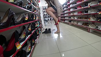 The girl in delicious thighs tries on shoes in a public store, and I peek and admire the big butt in panties. Footfetish and Voyeur.