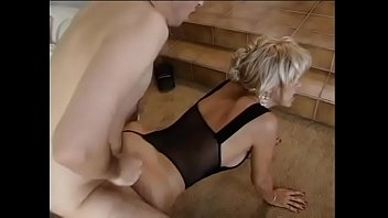 Elderly whore greedily sucks a young dude's cock and gives her ass