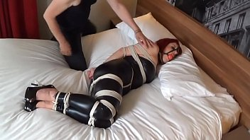 Tight bondage in latex
