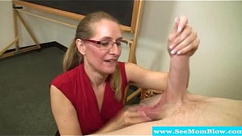 Mature teacher sucking on students cock