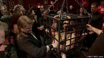 Big tits MILF Syren de Mer standing in small cage blindfolded and getting grope then with Simone Sonay cattle prodded in public party