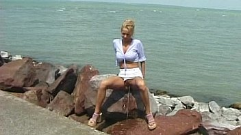 Crazy pee girl on the beach