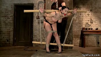 Watch Big tits gagged brunette slave Katrina Jade in lingerie tied to bamboo gets whipped then in hogtie pussy finger fucked by master in dungeon preview