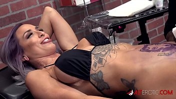 Sexy babe with huge tits gets a tattoo near her pussy then gets throat fucked