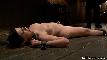 Busty brunette slave Nerine Mechanique is shackled and flogged on the floor then big ass caned and chained in backbend position on device bondage Thumbnail