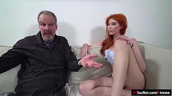 Busty Russian redhead Gisha lets an old guy in who should have had a date with her mom.Since shes not there she offers herself.They kiss and he sucks on her big tits.After some dry humping he licks her.She sucks his cock and lets him fuck her