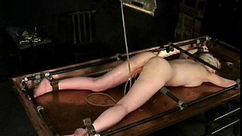Bondaged blonde tortured