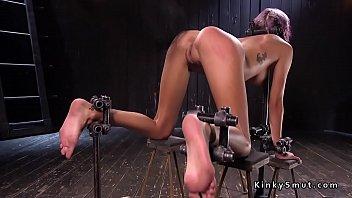 New slim pain slut hard whipped in metal device bondage