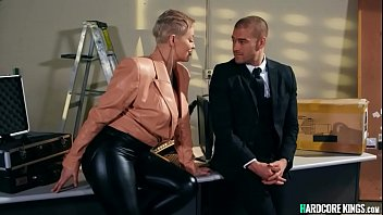 Huge tits short haired blonde MILF Ryan Keely in leather pants has business with mob who strips her off and rough fucks her on table in office