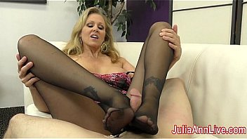 Milf Julia Ann is ready to make her slave pay, this time teasing her with stockings and lingerie. Slowly teasing his dick with her feet and making him cum when she wants! See the full video now! Thumbnail