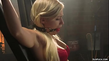 Bound to St Andrews Cross sexy blonde slave in red lingerie Gabi Gold gets whipped by baldheaded master Derrick Pierce then anal fucked