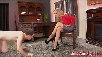 Busty Milf Julia Ann makes her little foot boy server her feet and high heels. Licking them up and down as she reads her book! See the full video and more! click the banner now!