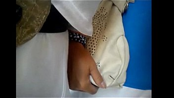touching woman in Bus