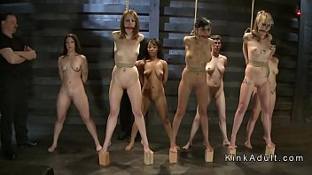 Group of naked slaves suffering rope bondage