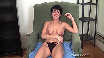 Kinky milf from Yanks Kassandra Wild fingering her shaved beaver to orgasm