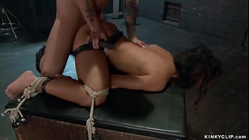 Master Mr Pete hangs for hands and gags hot brunette slave Teanna Trump and hard whips her then in rope bondage in bed rough bangs her pussy with big cock