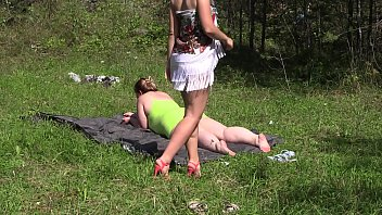 Lesbians shake fat booty, caress each other before having sex in nature. Foreplay from blonde with hairy pussy and BBW.