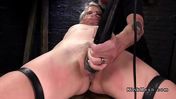 Blonde in back arch device bondage