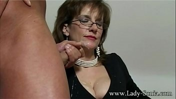 Lady Sonia has her face covered in cum after a hot blowjob