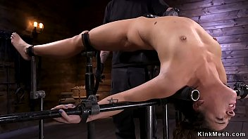 Brunette hottie in grueling device bondage gets pussy and whole body tormented and fucked with dick on a stick