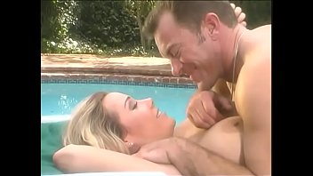 Fake boobs blonde supermodel Kristi Myst is riding dick near the pool