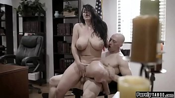 Busty councilwoman with a dirty secret is exploited by corrupt businessman.He wants her to satisfy him so she has no other choice then to throat his cock.On her desk she rides his cock vigorously.She gives him a titfuck and rides him again
