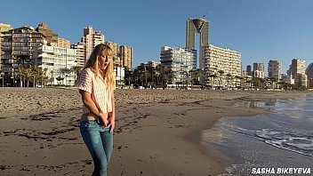 Risky masturbation on a public beach in Benidorm. Fetish Wet Sneakers. The girl pees beautifully in jeans. Fingering. Russian pornstar Sasha Bikeyeva