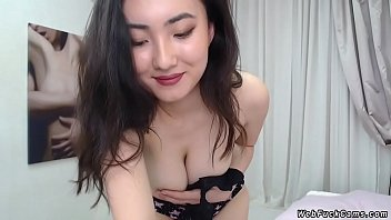 Petite brunette Asian amateur solo babe in black mini skirt stripping and flashing her nice pair of tits then posing naked in live webcam show
