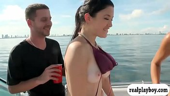 Two sexy girls enjoyed foursome action on speed boat