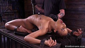 Suctioned nipples skinny ebony slave Kira Noir shackled in backbend position gets cattle prod then blindfolded in sitting bondage clit rubbed