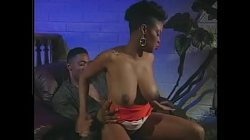 Black guy licks hairy pussy ebony babe and fucks her doggy style on the chair