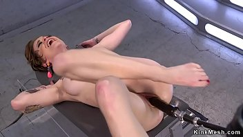 Short haired brunette babe Jeze Belle with tattoos in red high heels naked sitting and masturbating then fucking machine