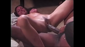 Lustful brunette with long hair takes a huge black cock in her wet pussy on the couch