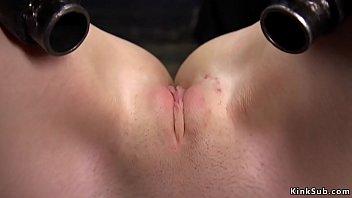 Hot brunette slut Charlotte Sartre gets her nice ass hard spanked to red then shaved pussy caned in metal device bondage