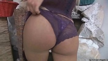 A sexy shemale in purple underwear masturbates