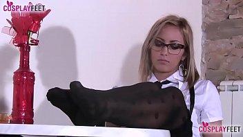 Blonde schoolgirl in stockings plays with her feet