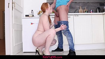MILF redhead babe Michelle Russo Seduces Younger Man In The Kitchen.