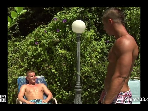 Two muscle gays sucking their cocks poolside