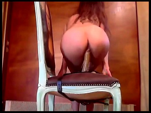Girl fucks didlo on chair